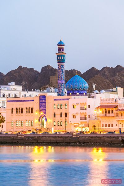 Oman, Muscat. Mutrah harbour and old town at dusk