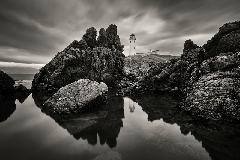 Reflection of Fanad Head Lighthouse in a Puddle