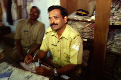 India - Kerala - Indian policemen in a police station in Ayamenam
