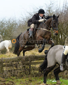 Max Chenery jumping the hunt jump at Newbold - The Fitzwilliam Hunt visit the Cottesmore at Burrough House
