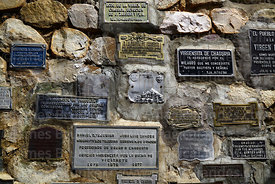Plaques giving thanks for miracles granted on wall outside Virgen de Chaguaya Sanctuary, Chaguaya, Tarija Department, Bolivia