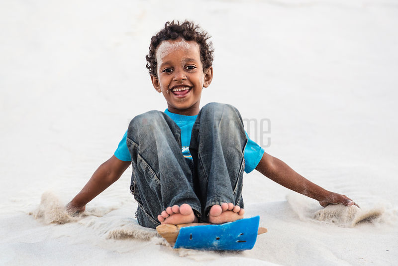 Ypong Child Sliding Down Sand Dune