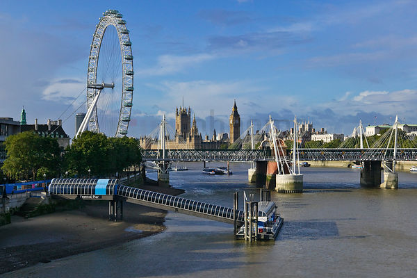Houses of Parliament with the Hungerford Bridge in the foreground.