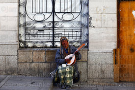 Blind man playing mandolin outside National Symphony Centre, La Paz, Bolivia