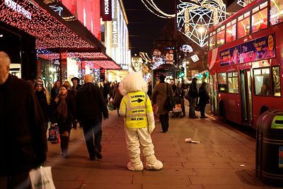 Promoter in Full Size Mascot Costume Standing in Oxford Street at Night