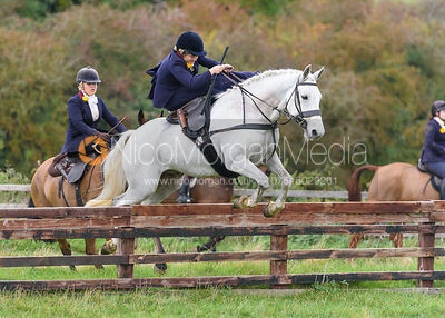 Stephanie Hensman jumping a hunt jump at Thorpe Satchville - Quorn Hunt Opening Meet 2016