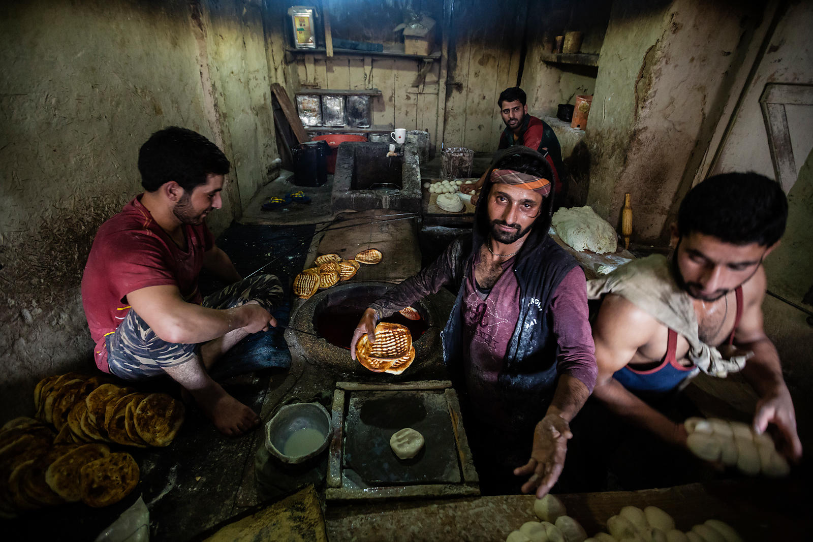 Men Cooking Flat Bread in a Tandoor Oven