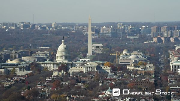 Over Capitol Hill, looking toward National Mall with Capitol rotunda, Washington Monument, and Lincoln Memorial in view. Shot...