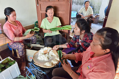 Women preparing sticky rice, Laos