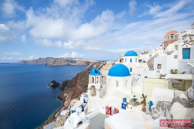 Iconic blue domed churches in Oia, Santorini, Greece