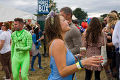 UK - Standon - A woman with a can of beer and a cigarette dances in a field to a mobile sound system at the Standon Calling F...