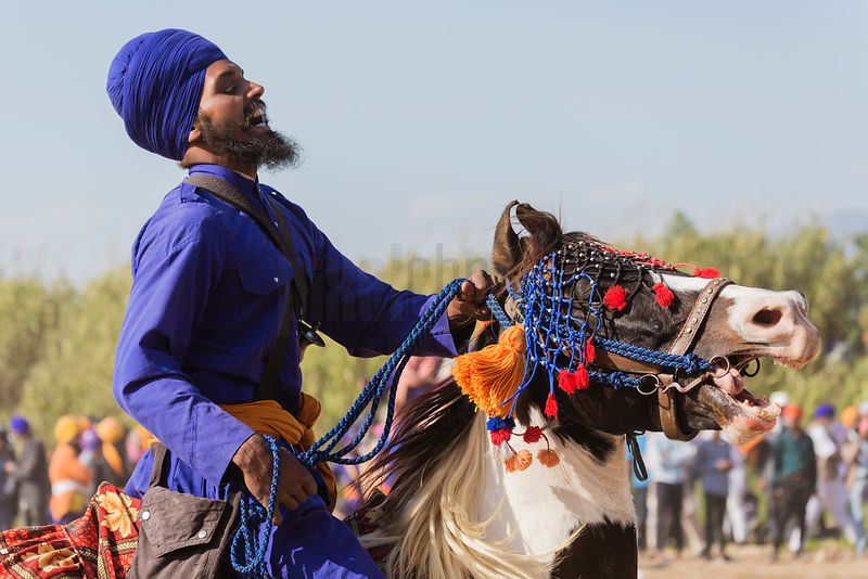 A Nihang Sikh Prepares for Horse Games at the Holla Mohalla Festival