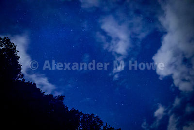 Altocumulus Clouds and Stars in a Night Sky