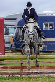 Lucinda Winnington jumping a hunt jump