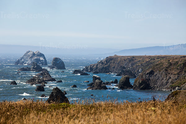 Beautiful view of craggy rocks and deep blue waters of the Northern California coast.