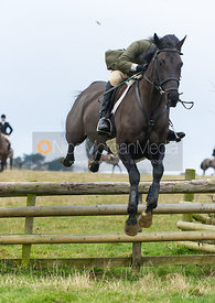 Jumping a hunt jump - The Cottesmore Hunt at Burrough House 18/12