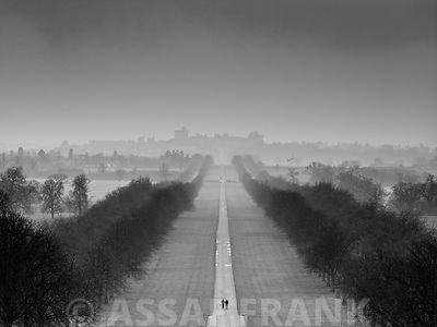 England, Berkshire, Aerial view of two people walking on long path with windsor castle in background (B&W)