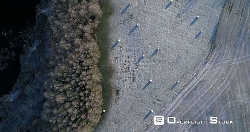 Aerial shot tracking over a field with light covering of snow, Akershus, Norway, November 2017.