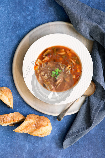 Bowl of Minestrone soup and crusty bread.