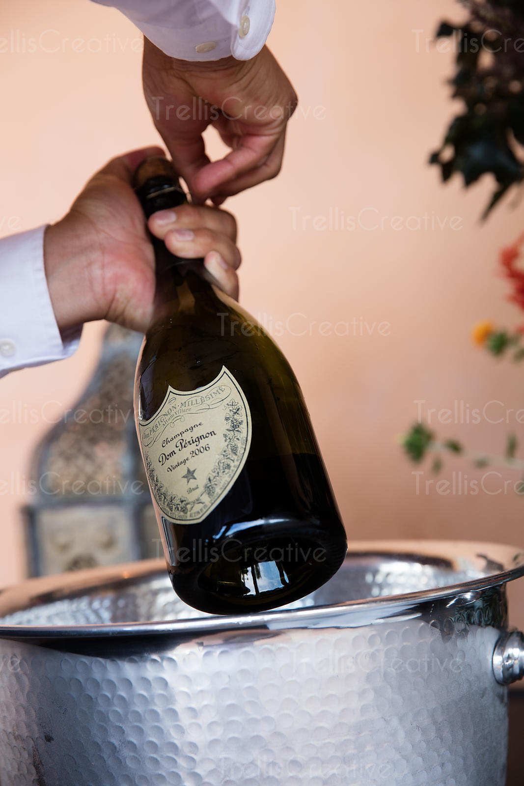 Close-up of a waiter opening a bottle of champagne