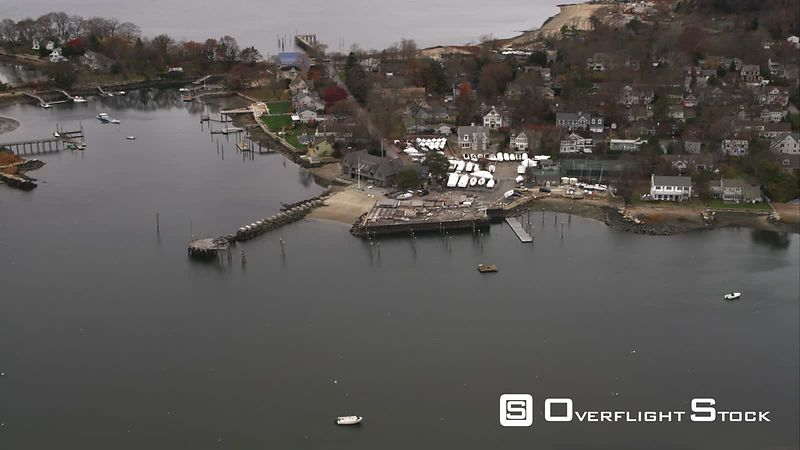 Over Coastal Residential Area to Reveal Cove Harbor With Stamford, Connecticut in Background. Shot in November
