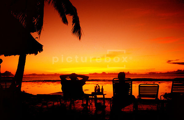 Sunset couple1, Cook Islands by Paul Thomas Gooney