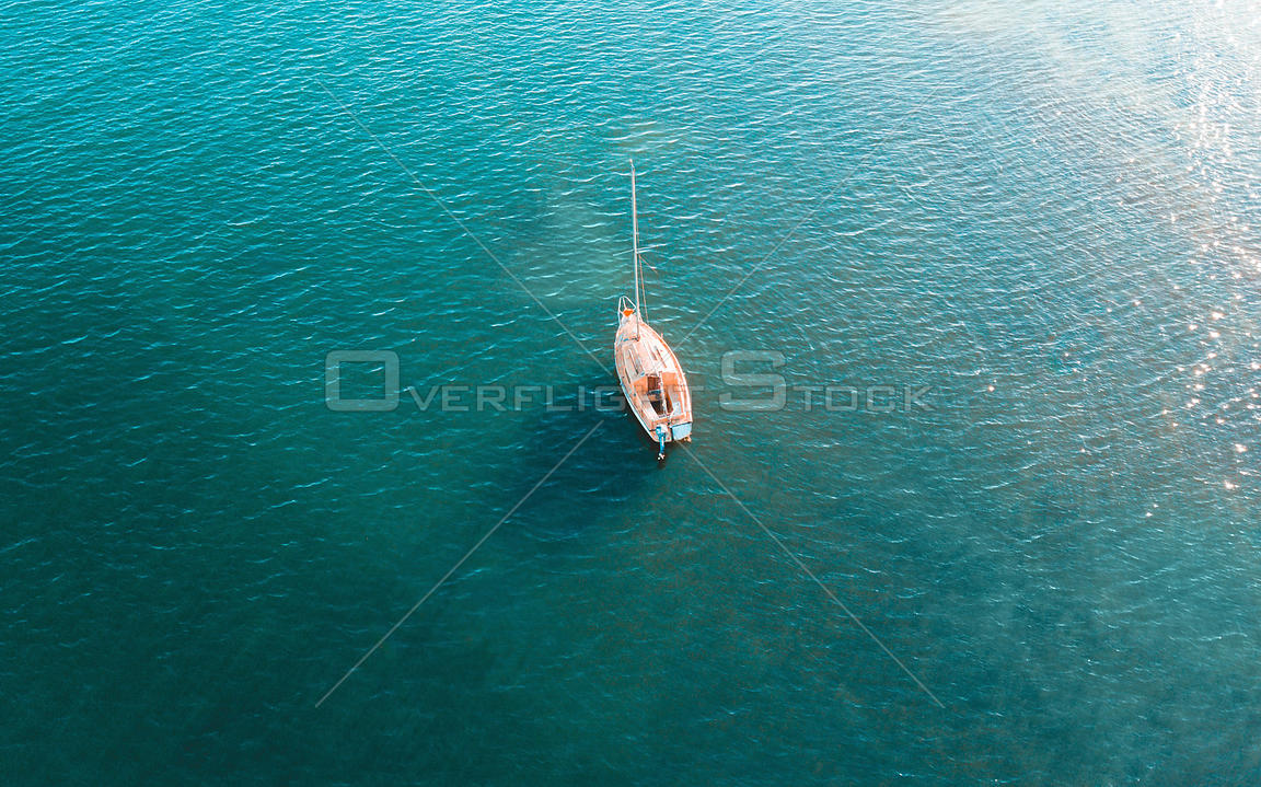Overhead view of yacht on beautiful blue waters. NSW Australia
