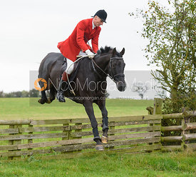 Joss Hanbury jumping a hunt jump at Thorpe Satchville - Quorn Hunt Opening Meet 2016