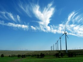 Wind towers with cirrus clouds