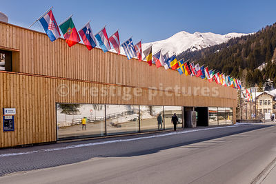 Davos Congress Centre with nation flags outside - Royalty free stock photo