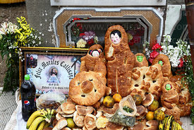 Detail of tomb decorated with bread offerings, fruit and coca leaves, Todos Santos festival, La Paz, Bolivia