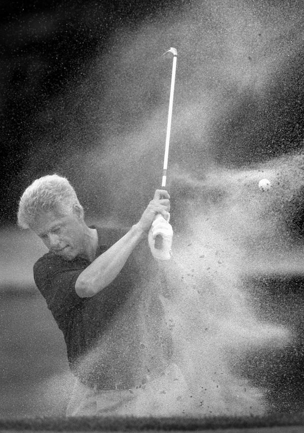 President William Clinton enjoys golf just outside of Washington D.C.