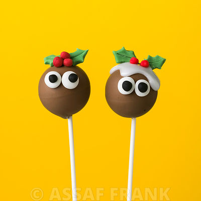 Two christmas pudding pop cakes