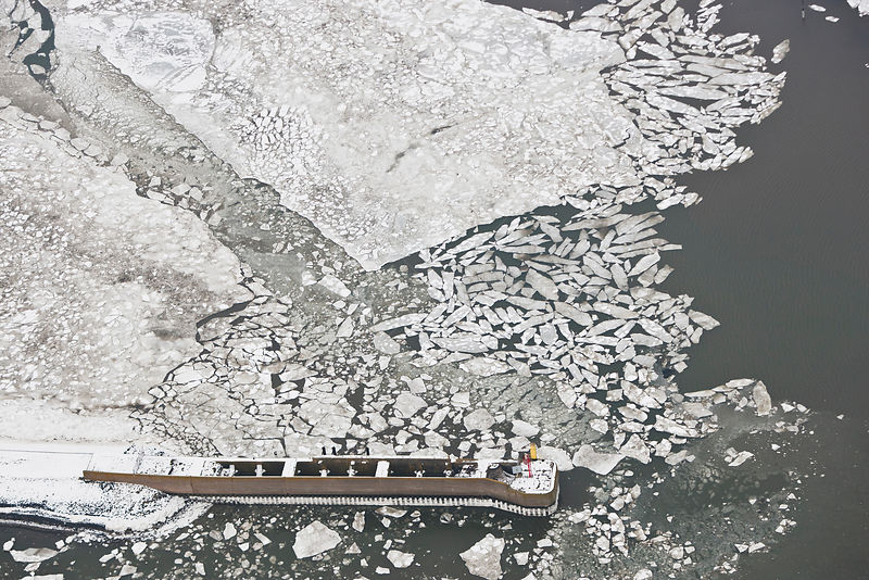 Aerial view of frozen harbour of Langeoog in winter with ice sheets and snow, East Frisia, North Sea, Lower Saxony, Germany F...