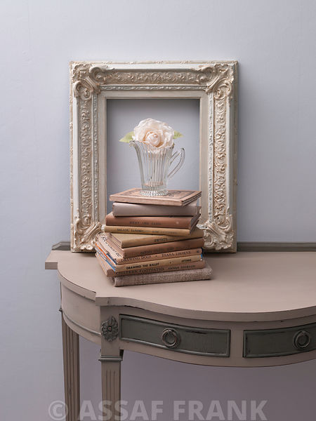 Books with Vase and photoframe on table