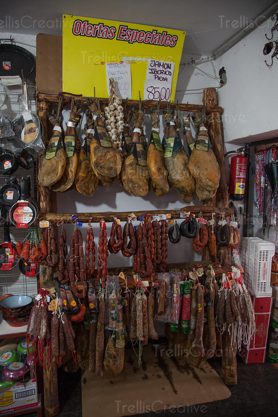 Various dried sausages and ham in shop