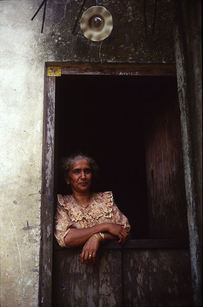 India - Kerala - An India woman whose house backs onto a waterway