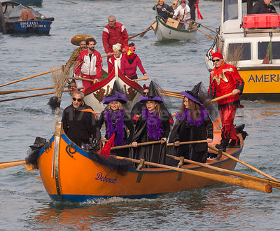 Women wearing  Witch Costumes in the Venice Carnival Water Parade