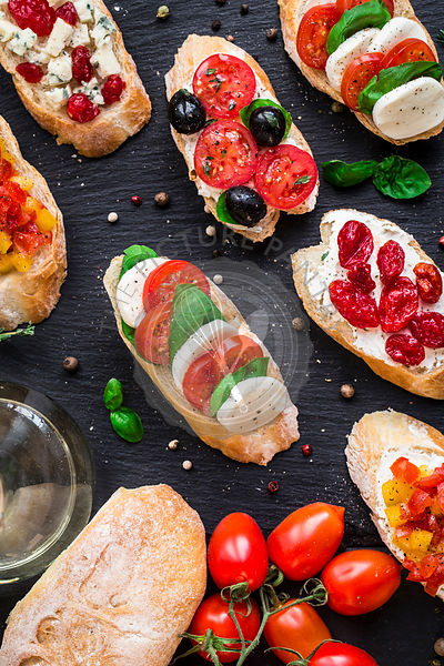 Bruschettas with tomatoes, herbs and olives