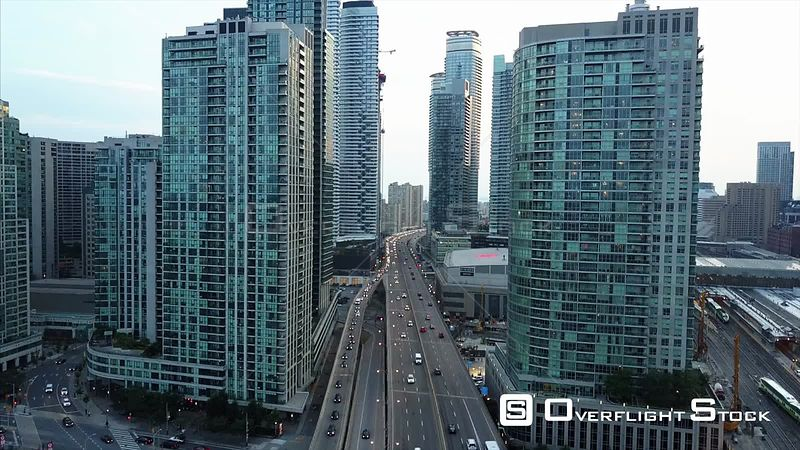 Air Canada Center Garninder Expressway. Dusk Look During Solar Eclipse. Drone Video Downtown CN Tower Toronto Ontario Canada