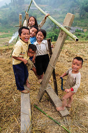 Hmong Children Standing on Rice Sifting Platform