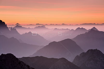 The Julian Alps at sunset, looking north into Italy from Mangrt at 2500m, Triglav National Park, Gorenjska, Slovenia, October...