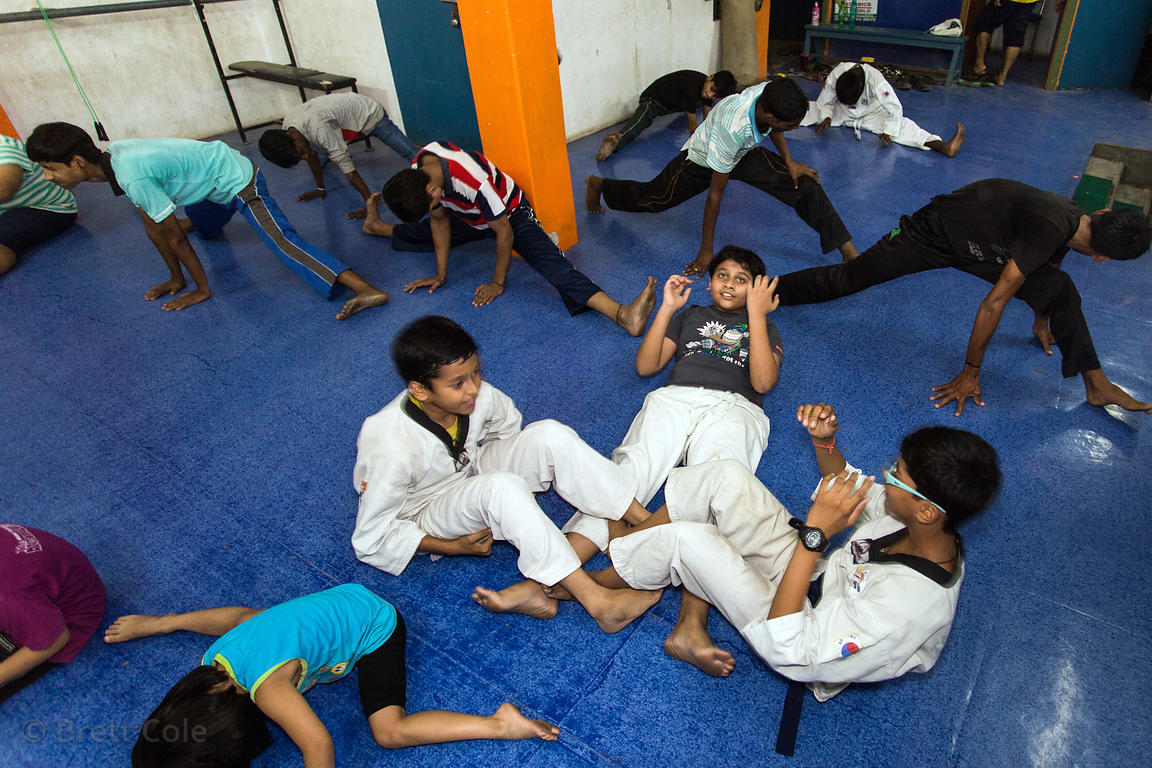Children participate in a karate class, Dumraon Colony, Varanasi, India