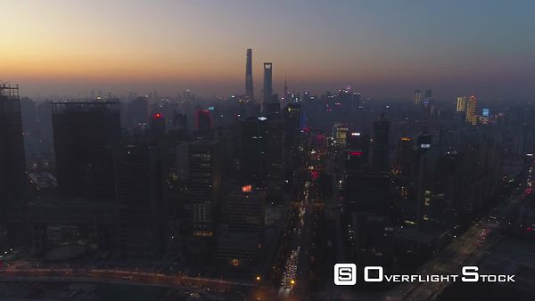 Shanghai Skyline at Sunset. Lujiazui District and Century Avenue. Aerial View. Drone is Flying Sideways and Upward. Establish...