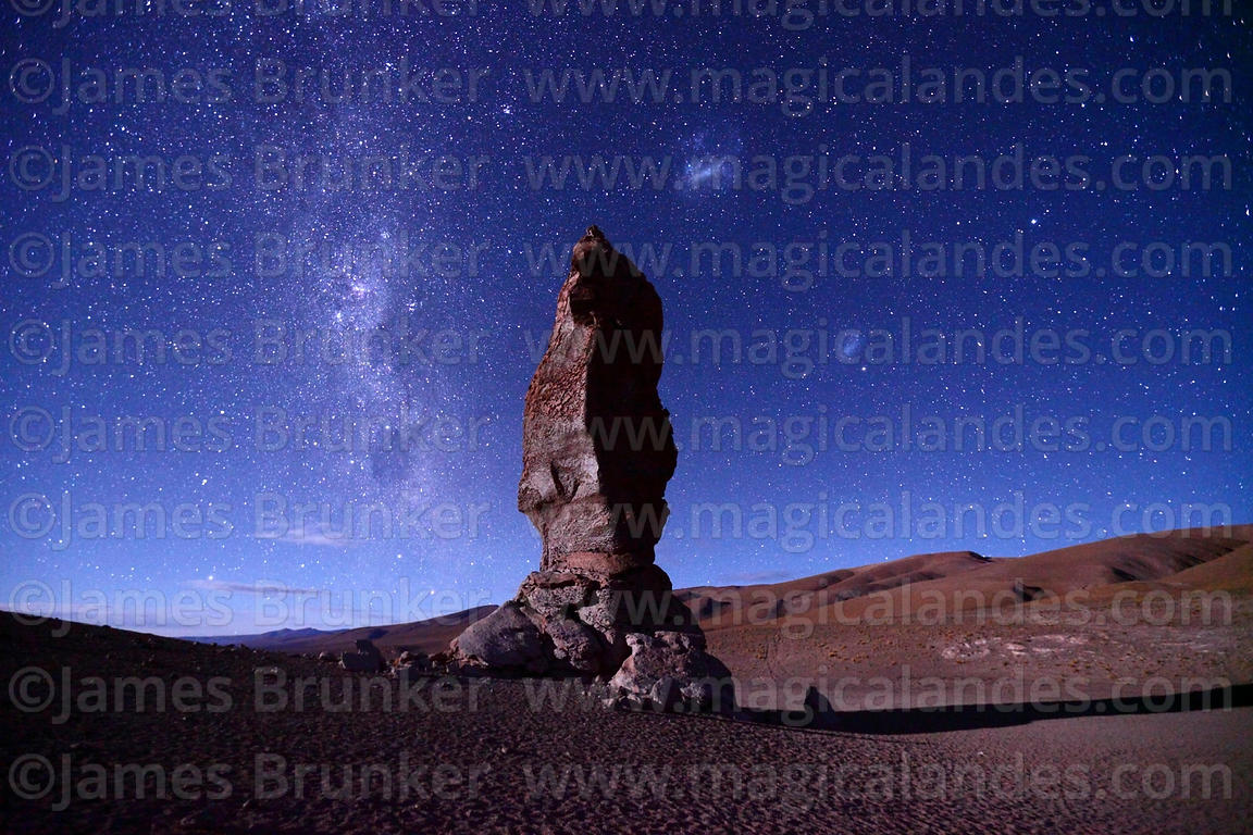 Milky Way and Magellanic Clouds above Moai de Tara / Monjes de la Pacana rock formation, Los Flamencos National Reserve, Chile