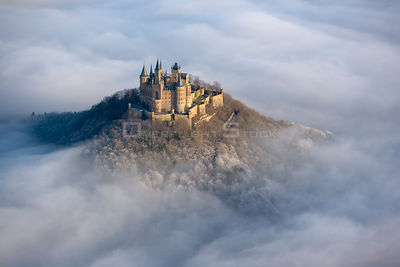 Hohenzollern castle emerging from the mist, Baden-wuerttemberg, Germany