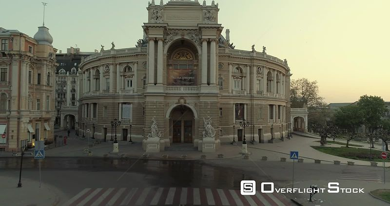 Aerial camera slowly climbs towards the Odessa Opera Theatre at sunrise Ukraine
