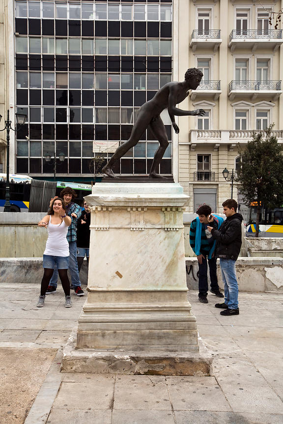 Greece - Athens - Teenagers dance in front of a statue in Syntagma Square