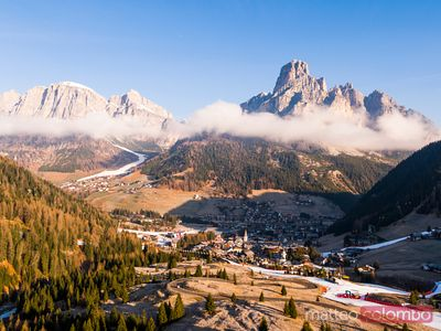Aerial view over Corvara town, Val Badia, Dolomites
