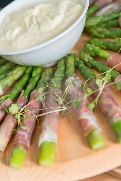 Asparagus wrapped in ham with dip, Savoury Canapes on a tray.